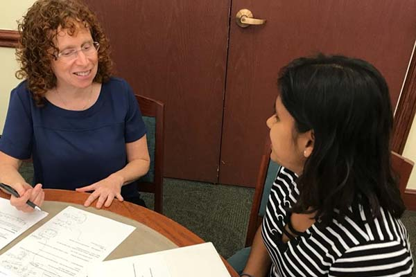 college admissions expert bonnie r rabin meeting with a young client in the library