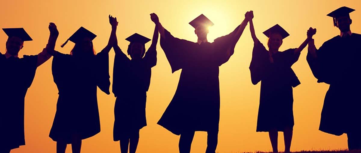 graduating college seniors celebrating