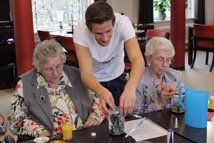 a student volunteer helping the elderly