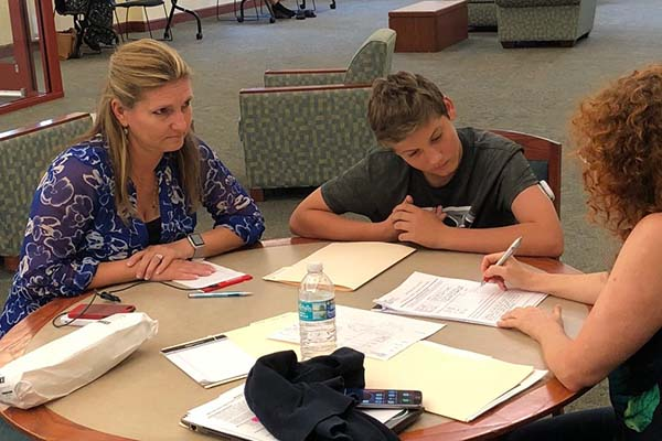 College advisor Bonnie R. Rabin with a parent and student