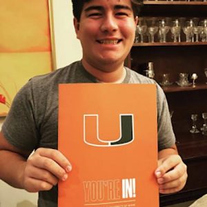 student with his miami acceptance letter